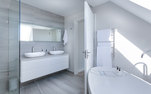 simple white bathroom with tub
